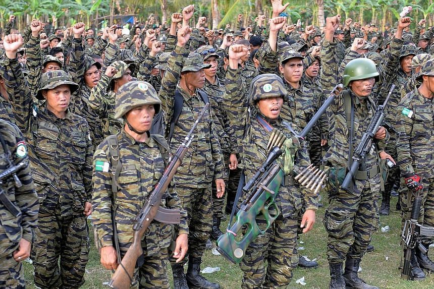 Moro Islamic Liberation Front (MILF) rebels in their camp onMindanao in 2014. -- PHOTO: AFP
