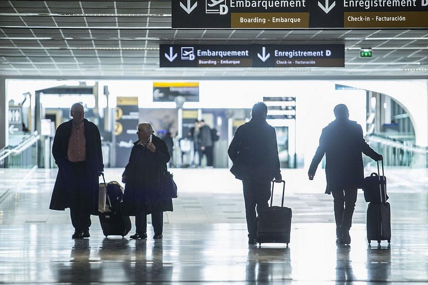 Passengers at Toulouse-Blagnac airport in Toulouse, France, on Jan 28, 2015. A record 3.3 billion passengers boarded planes last year, marking a jump of some 170 million passengers from 2013, the International Air Transport Association  sai
