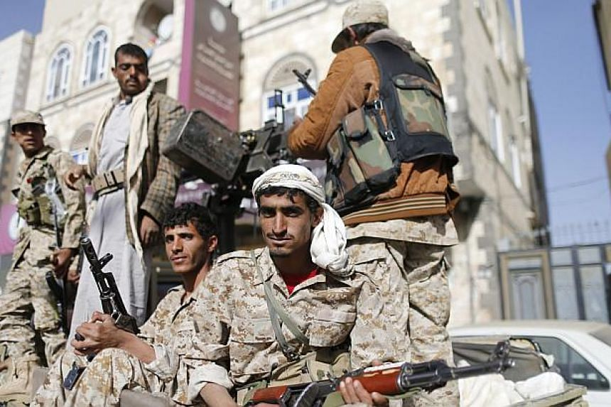 Huthi fighters ride a truck while patrolling a street in Sanaa Jan 21, 2015. -- PHOTO: REUTERS