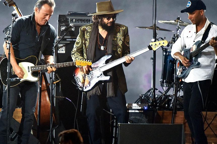 (Left-right) Singer Bruce Springsteen, musician Don Was and musician Tom Morello perform onstage at the 25th anniversary MusiCares 2015 Person Of The Year Gala honoring Bob Dylan at the Los Angeles Convention Center on Feb 6, 2015, in Los Angeles, Ca