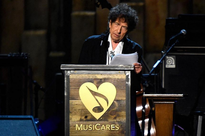 Honoree Bob Dylan speaks onstage at the 25th anniversary MusiCares 2015 Person Of The Year Gala honoring Bob Dylan at the Los Angeles Convention Center on Feb 6, 2015, in Los Angeles, California. -- PHOTO: AFP
