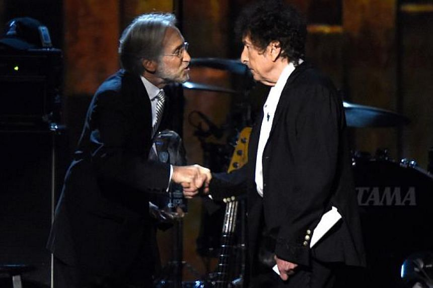 National Academy of Recording Arts and Sciences President Neil Portnow (left) and honoree Bob Dylan appear onstage at the 25th anniversary MusiCares 2015 Person Of The Year Gala honoring Bob Dylan at the Los Angeles Convention Center on Feb 6, 2015 i
