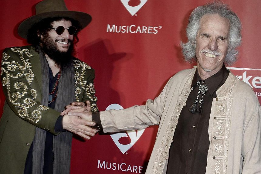 US musicians Don Was (left) and John Densmore (right) arrive for the 2015 MusiCares Person of the Year gala in Los Angeles, California, US, on Feb 6, 2015.  -- PHOTO: EPA