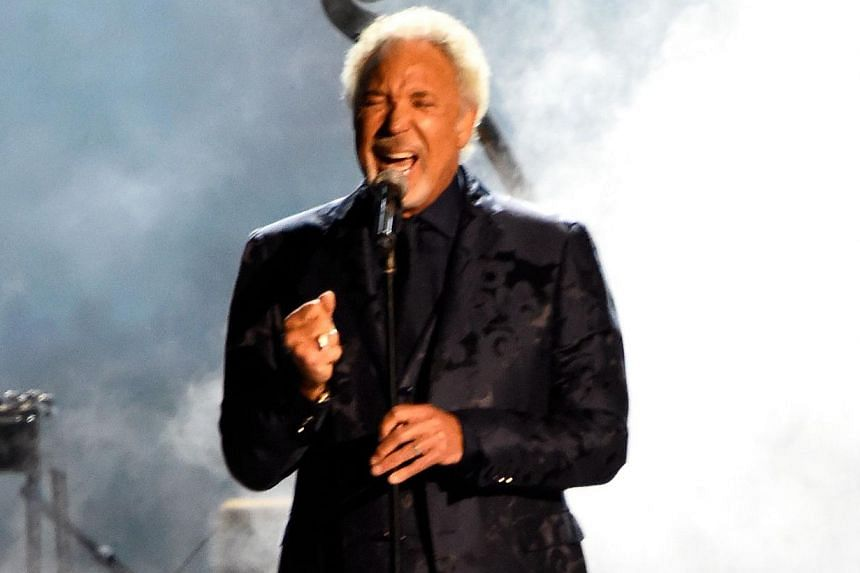 Singer Tom Jones performs onstage at the 25th anniversary MusiCares 2015 Person Of The Year Gala honoring Bob Dylan at the Los Angeles Convention Center on Feb 6, 2015, in Los Angeles, California.  -- PHOTO: AFP