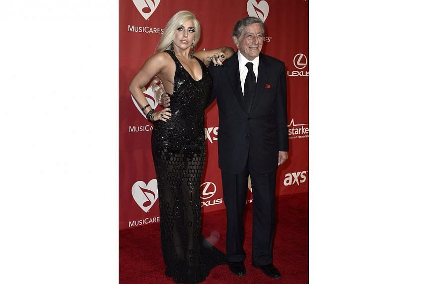 US singers Lady Gaga (left) and Tony Bennett (right) arrive for the 2015 MusiCares Person of the Year gala in Los Angeles, California, US on Feb 6, 2015. -- PHOTO: EPA