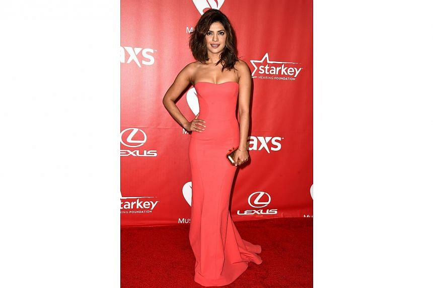 Actress Priyanka Chopra attends the 25th anniversary MusiCares 2015 Person Of The Year Gala honoring Bob Dylan at the Los Angeles Convention Center on Feb 7, 2015, in Los Angeles, California. -- PHOTO: AFP