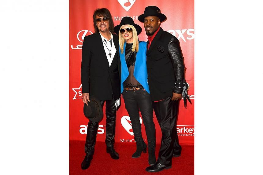 (left-right) Musicians Richie Sambora, Orianthi, and Michael Bearden attend the 25th anniversary MusiCares 2015 Person Of The Year Gala honoring Bob Dylan at the Los Angeles Convention Center on Feb 6, 2015 in Los Angeles, California. -- PHOTO: AFP