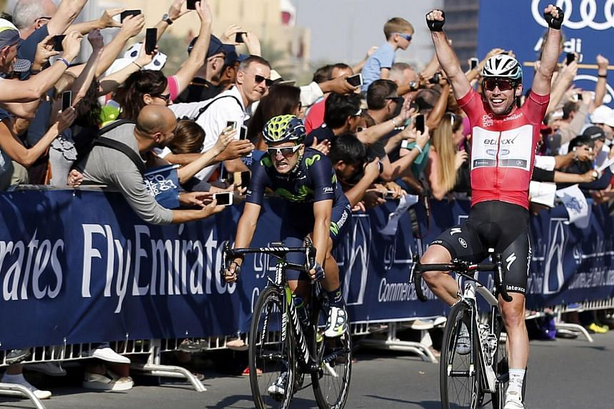 Briton Mark Cavendish (right) of Etixx-Quick-Step team reacts at the end of the fourth and last stage of the Dubai tour on Feb 7, 2015. Cavendish won cycling's Dubai Tour after sprinting to victory in the fourth and final stage on Saturday. -- P