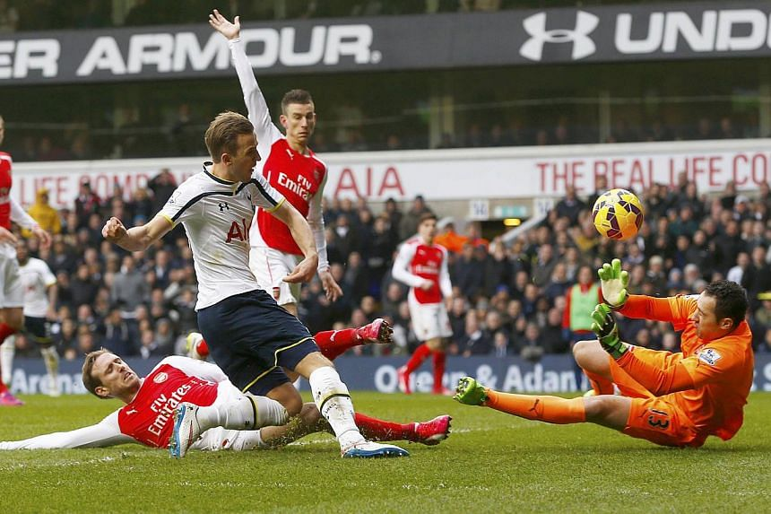 David Ospina of Arsenal saves a shot from Harry Kane of Tottenham Hotspur during their English Premier League soccer match at White Hart Lane, London on Feb 7, 2015. Local hero Kane scored twice as Tottenham Hotspur leapfrogged Champions League quali