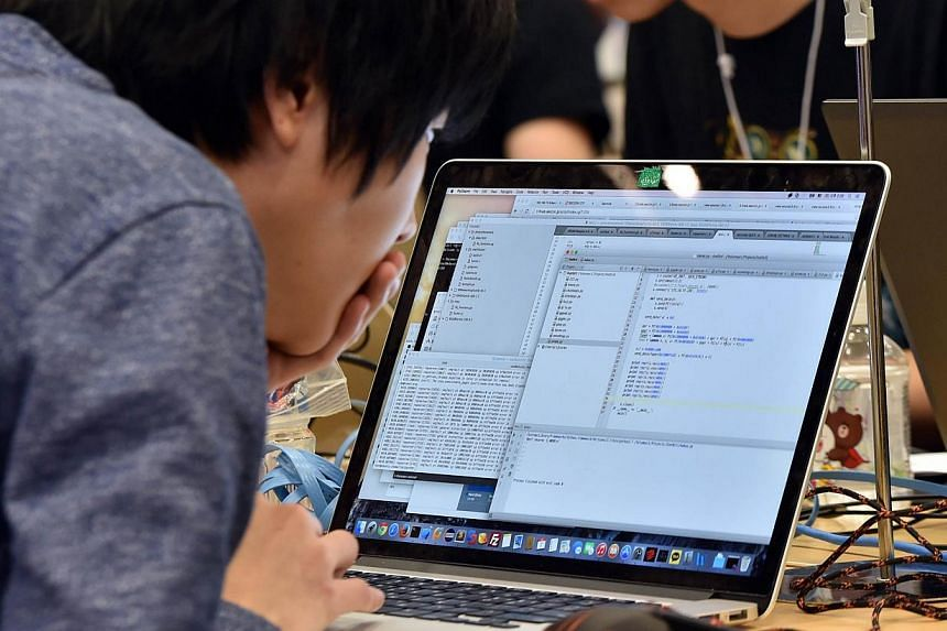 Participants from seven nations and regions from China, Japan, Poland, Russia, South Korea, Taiwan, and the United States compete in their hacking skills at the final rounds of the Security Contest 2014, SECCON on Feb 7, 2015. -- PHOTO: AFP