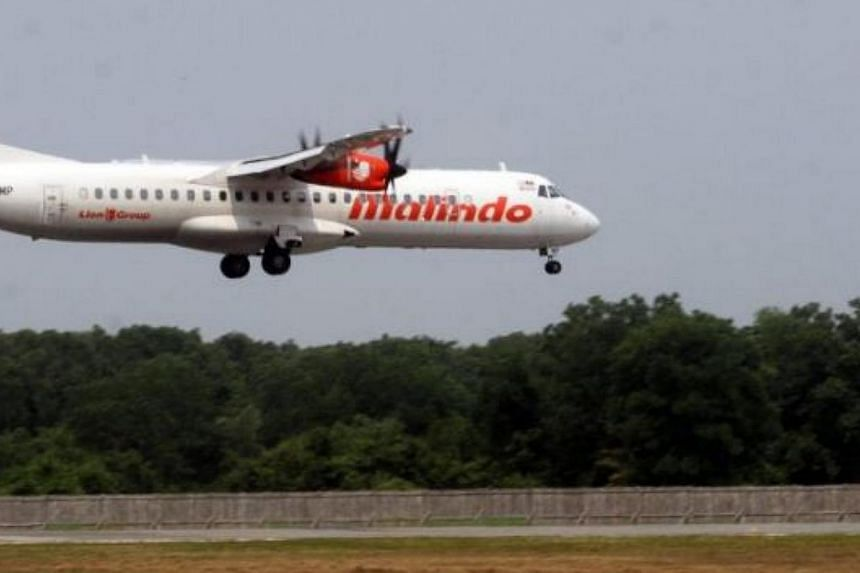 """Some 20 passengers on a Malindo Air flight bound for Subang Airport in Kuala Lumpur disembarked from the aircraft minutes before take-off after hearing what they claimed was """"a loud argument from the cockpit"""". -- PHOTO: THE STAR/ASIA NEWS NETWORK&nbs"""
