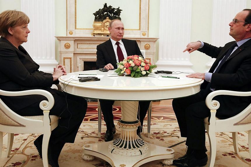 (From left) German Chancellor Angela Merkel and Russia's President Vladimir Putin listen to French President Francois Hollande during a meeting on resolving the Ukraine crisis at the Kremlin in Moscow onFeb 6, 2015. The leaders of Russia, Germa