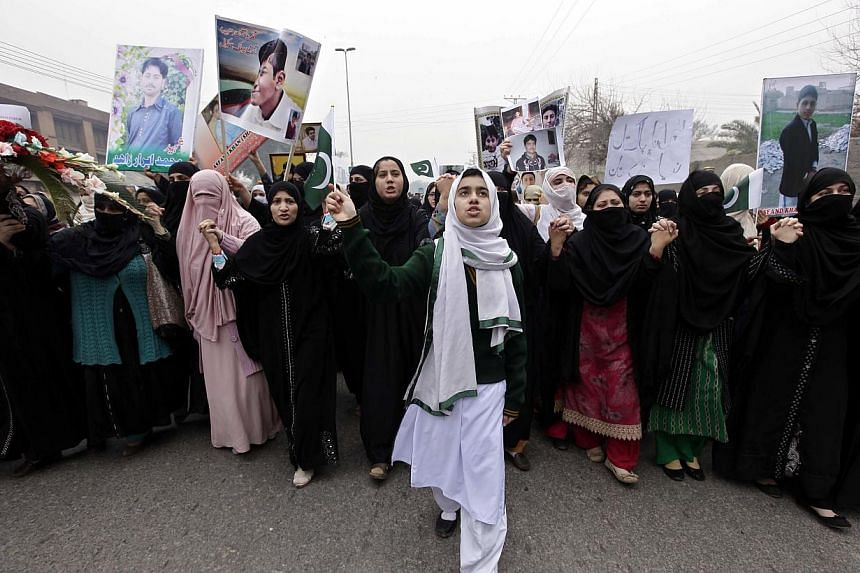 Relatives of the students, who were killed by Taleban militants during an attack at Army Public School, chant slogans during a protest demanding that the culprits of the attack be brought to justice, in Peshawar, Pakistan on Feb 7,2015. Hundred