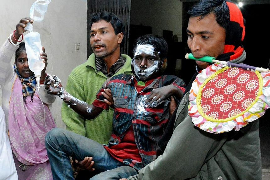 People carry a youth who suffered burn injuries after a petrol bomb attack on a bus on Gaibandha some 285 km from Dhaka on Feb 7, 2015, during an ongoing blockade called by the Bangladesh Nationalist Party (BNP)-led alliance.-- PHOTO: AFP