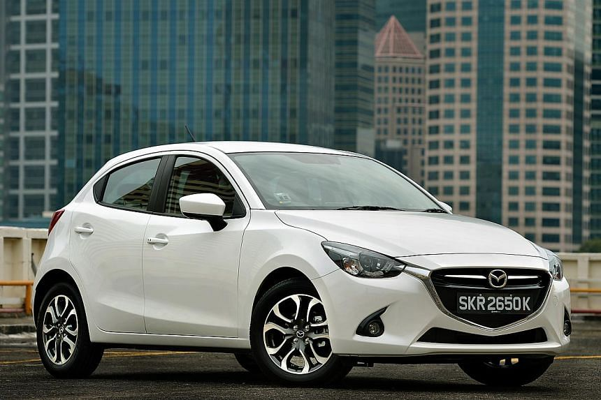 The new Mazda2 looks good inside and out, with a front that resembles a beaming face.