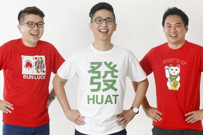 Fictive Fingers' Hani and Aisah Dalduri (both above) have designed a special Japanese wrap cloth that can be used to hold food. Wet Tee Shirt's (from far left) sales manager Benson Khee, owner Brandon Lee and customer service officer Edmund Chew in t