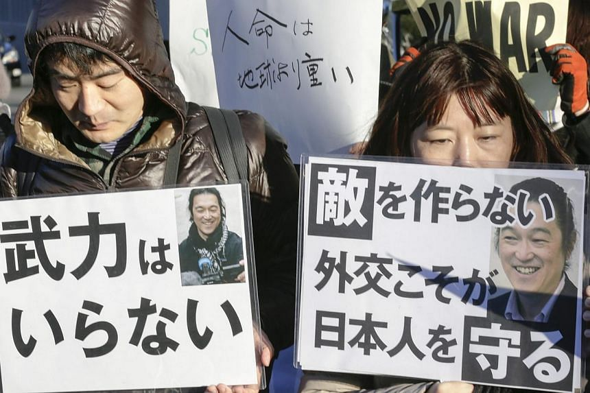 Grief-stricken Japanese holding a silent prayer rally early this week after the murder of two hostages by ISIS militants. The hostage crisis demonstrates the range of security challenges Tokyo is managing, none more perplexing than the rise of China.