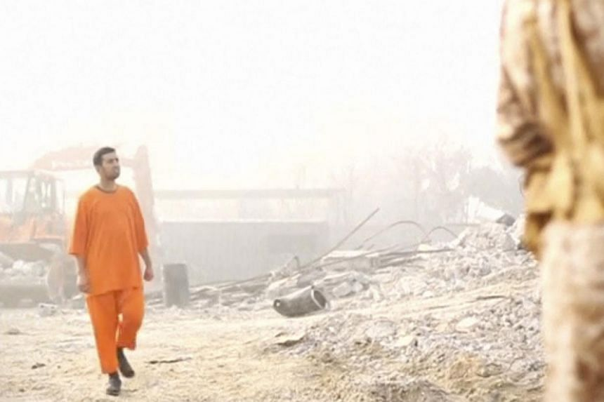 A still image from a video made available on social media purportedly shows Jordanian pilot Muath al-Kasaesbeh in an undisclosed location. Lieutenant Kasaesbeh was burned alive by ISIS militants, allegedly in retaliation for dropping a bomb from his