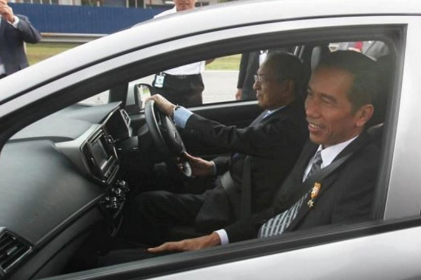 President of indonesia Joko Widodo taking a ride in the new proton Iriz driven by Proton Chairman Tun Mahathir Mohamad during his visit to the Proton centre of Excellence in Shah Alam. -- PHOTO: THE STAR/ ASIA NEWS NETWORK