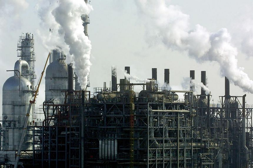 Steam rises from theChina Petrochemical Corp (Sinopec Group) oil refinery on the outskirts of Beijing, China onFriday, Jan 17, 2003. China's anti-corruption watchdog said on Saturday that it had uncovered evidence of graft at Sinopec Grou