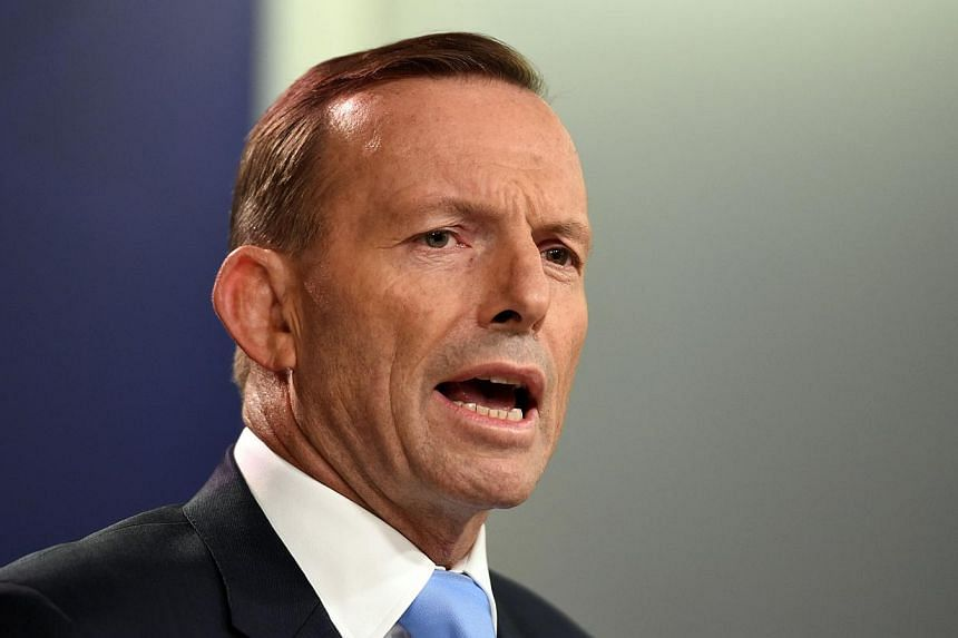 Australia's Prime Minister Tony Abbott speaking during a press conference in Sydney on Feb 6, 2015. -- PHOTO: AFP