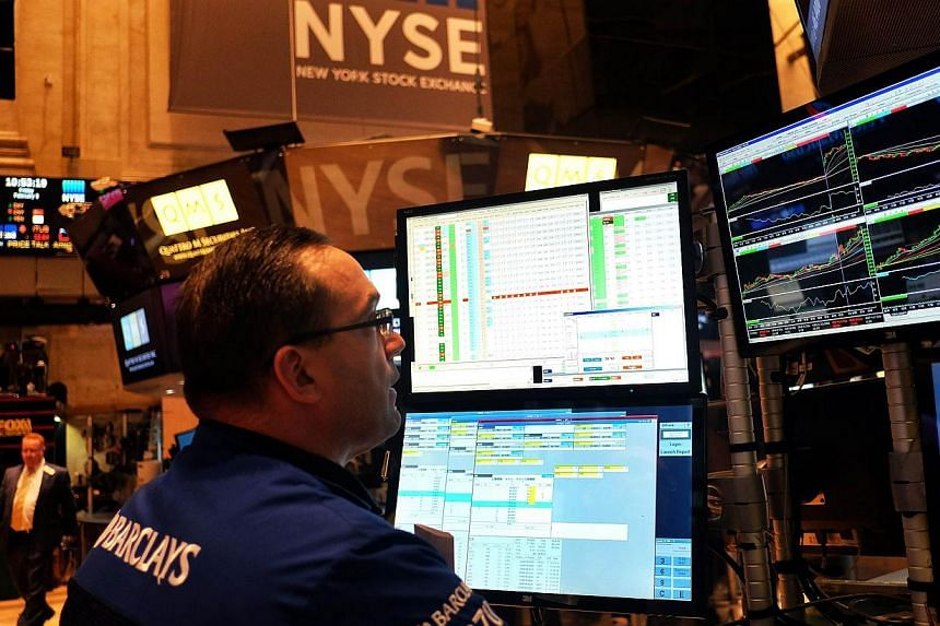 A trader works on the floor of the New York Stock Exchange (NYSE) on Feb 6, 2015, in New York. -- PHOTO: AFP