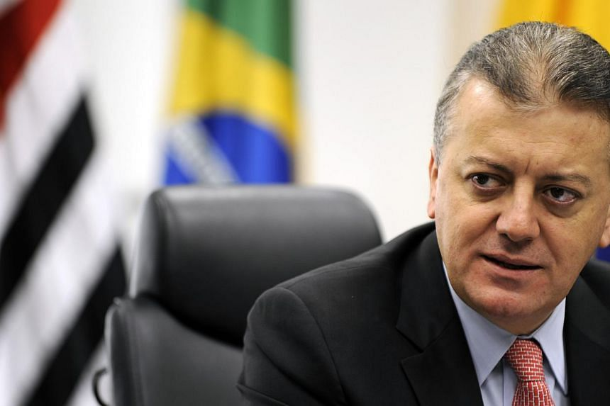 Shares in Brazilian oil giant Petrobras plunged Friday as banking executive Aldemir Bendine (above), who is seen as close to President Dilma Rousseff's party, was named the scandal-hit firm's new chief executive. -- PHOTO: BLOOMBERG