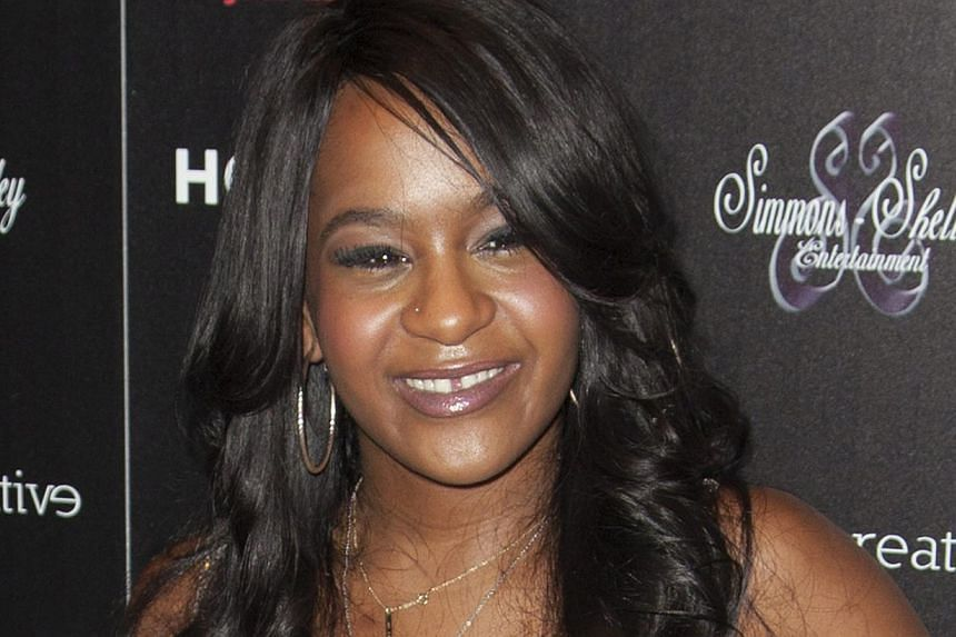 Two relatives of singer Bobby Brown - whose 21-year-old daughter with Whitney Houston, Bobbi Kristina (above), is said to be fighting for her life in Atlanta after being found unresponsive in a bathtub - got into a fight early Friday at a downtown ho