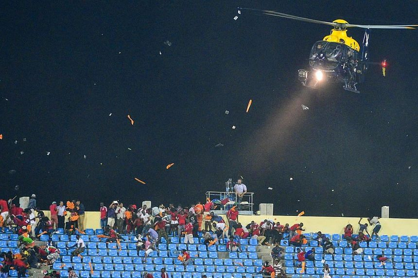 A police helicopter is used to disperse rioting fans from pelting Ghanaian fans with projectiles during the 2015 Africa Cup of Nations semi final match between Ghana and Equatorial Guinea at the Malabo Stadium, Malabo, Equatorial Guinea on Feb 5, 201