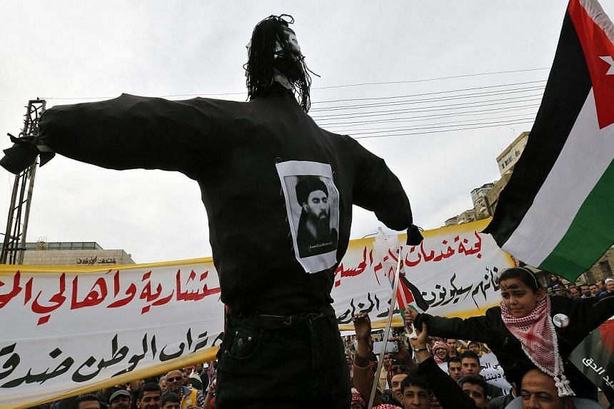 Jordanian protesters carry an effigy of leader of the militant Islamic State Abu Bakr al-Baghdadi, during a march after Friday prayers in downtown Amman on Feb 6, 2015. -- PHOTO: REUTERS