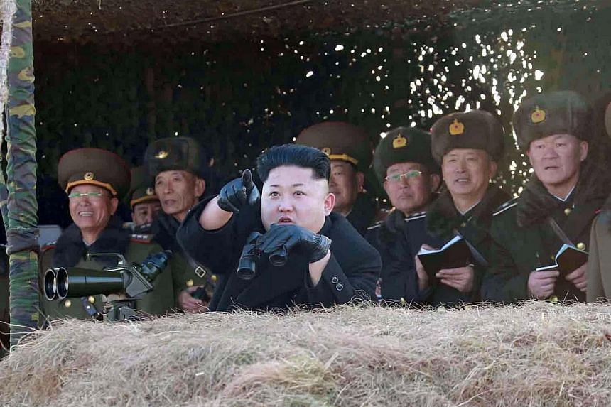 This undated picture released from North Korea's official Korean Central News Agency (KCNA) on Jan 31, 2015 shows North Korean leader Kim Jong Un inspecting a drill of the Korean People's Army (KPA) for hitting a naval target at undisclosed place in