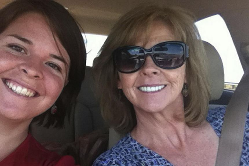 Kayla Mueller (left), 26, an American humanitarian worker from Prescott, Arizona is pictured with her mother Marsha Mueller in this undated handout photo obtained by Reuters Feb 6, 2015. -- PHOTO: REUTERS