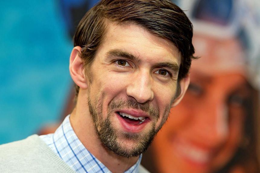 Olympic superstar Michael Phelps (above) will make his return to competitive swimming at the Arena Pro Swim Series, formerly the Mesa Grand Prix, in April, his coach confirmed on Friday. -- PHOTO: EPA