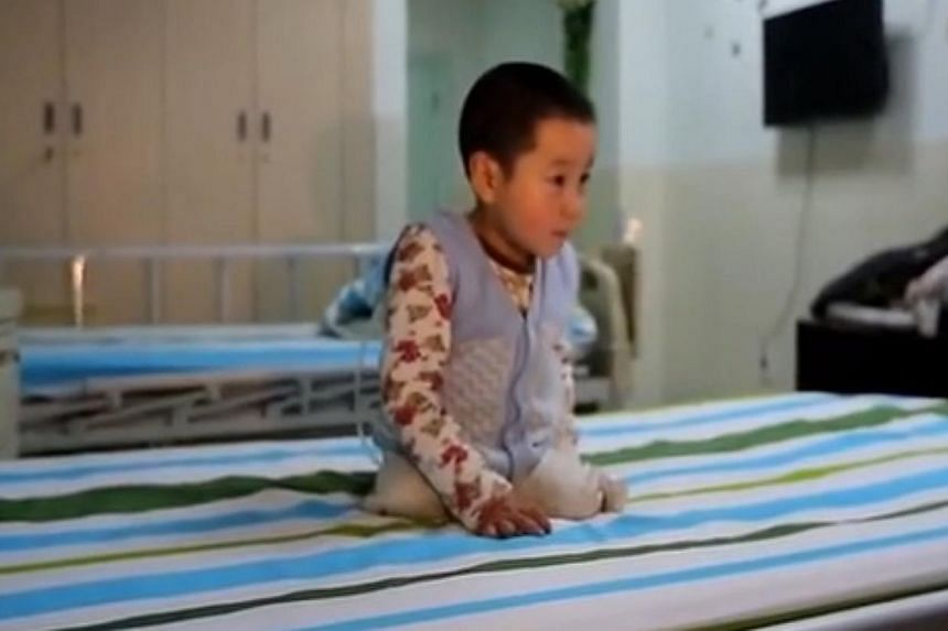 Xiao Feng, as the boy is affectionately known in Chinese media, was filmed prancing and flipping on his hospital bed in the central Hubei province using his arms and the stumps of what used to be his legs. -- PHOTO: YOUTUBE SCREENGRAB