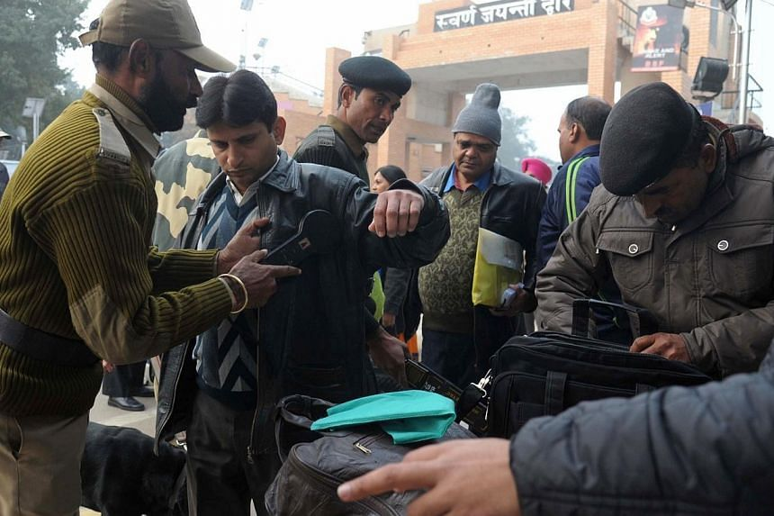 Indian border and customs personnel screen Pakistani nationals travelling on the Delhi-Lahore bus on Jan 8, 2015. India and Pakistan have suspended trade across their de facto border in the disputed territory of Kashmir after Indian authorities detai