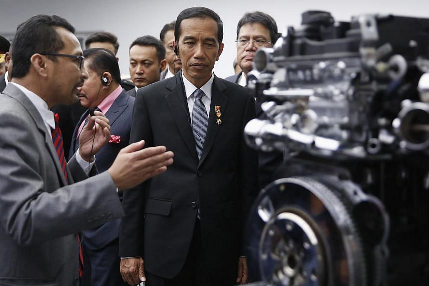 Indonesian President Joko Widodo tours the Proton factory, Malaysia's national car manufacturer, during a state visit, in Shah Alam on Feb 6, 2015. He willarrive on his first state visit to the Philippines today.-- PHOTO: REUTERS
