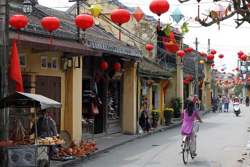In the ancient port city of Hoi An, travellers can take in the sights of the pedestrian streets (left) as well as the Japanese bridge (above), which dates from the 16th century. Da Nang boasts long strips of white sand beaches overlooking the South C