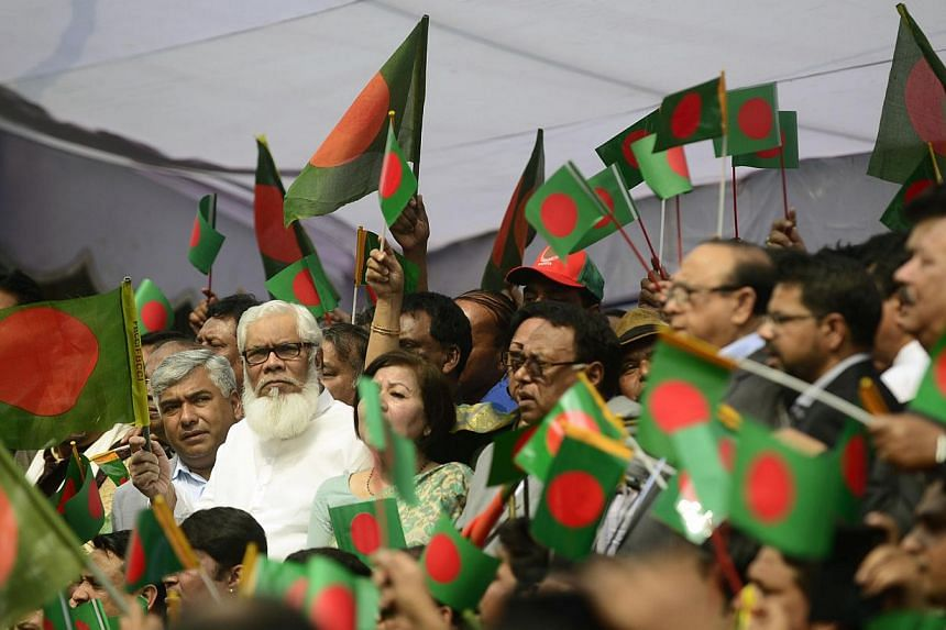 Bangladesh businessmen wave the national flag as they take part in a protest against an ongoing nationwide strike and blockade called by the Bangladesh Nationalist Party (BNP)-led alliance, whichthey say has cost the economy nearly S$13 billion
