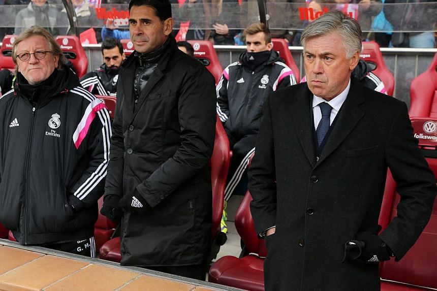 Real Madrid's Italian head coach Carlo Ancelotti (right) looks on prior to his team's derby match against Atletico Madrid on Feb 7, 2015. Atletico won 4-0. -- PHOTO: AFP