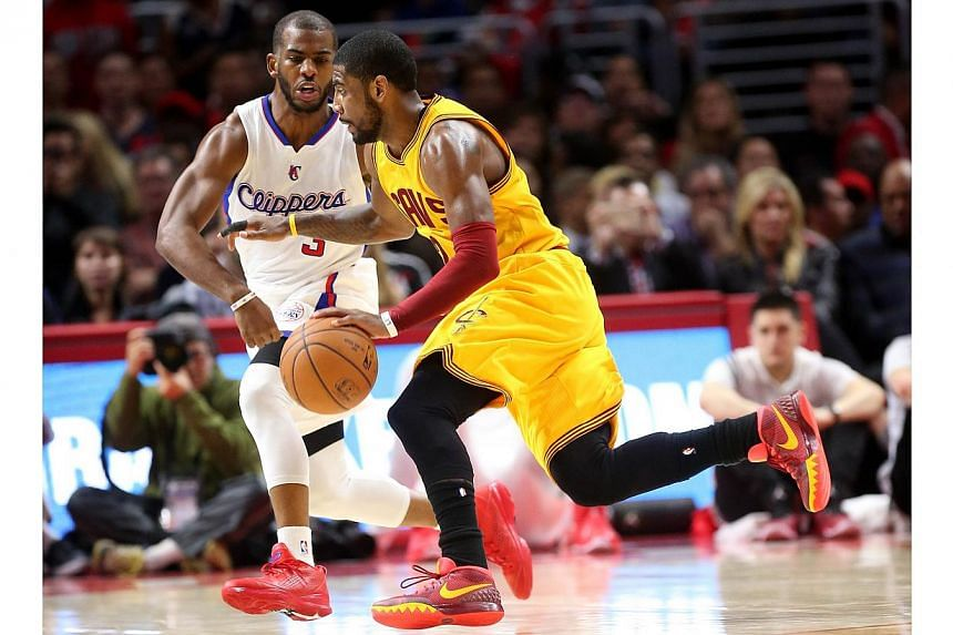 Kyrie Irving of the Cleveland Cavaliers drives against Chris Paul of the Los Angeles Clippers at Staples Centre on Jan 16, 2015 in Los Angeles, California. -- PHOTO: AFP