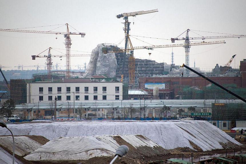 This picture taken on Feb 2, 2015 shows the construction site of the Disney amusement park in Shanghai. The opening of Disney's first mainland China theme park has been pushed back to 2016. -- PHOTO: AFP