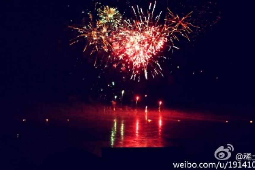 """The picture of heart-shaped fireworks posted on Zhang Ziyi's Weibo account, where she wrote:""""Yes, I will (marry you)."""" -- PHOTO: ZHANG ZIYI'S WEIBO ACCOUNT"""