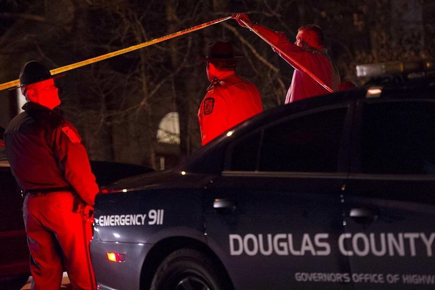 Douglas County Sheriff's Office deputies and investigators outside the crime scene of a home in a suburban neighbourhood in Douglasville, Georgia, on Feb 7, 2015. -- PHOTO: REUTERS