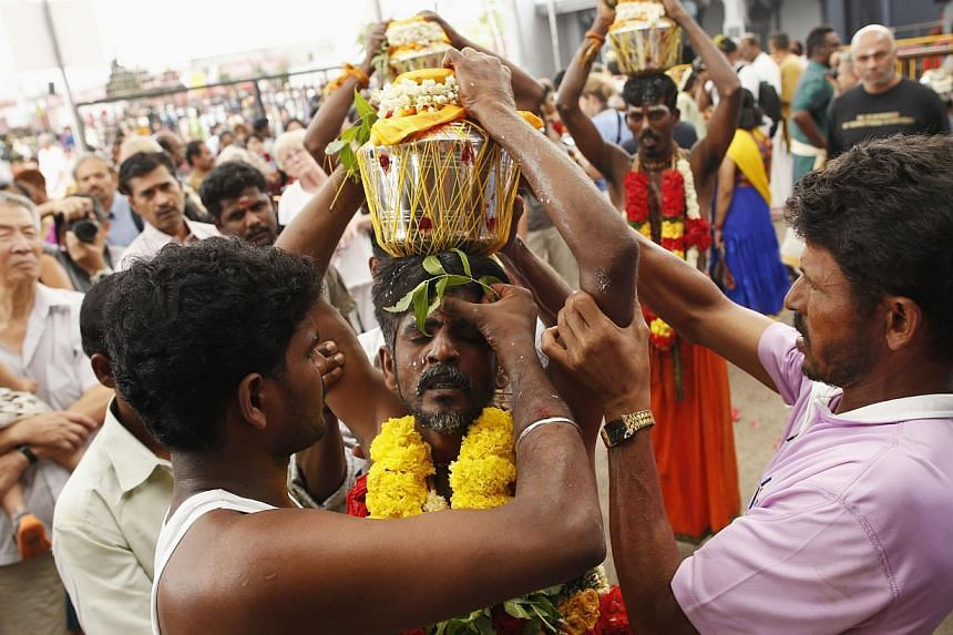 Devotees carrying milk pots over their heads during Thaipusam on Feb 3, 2015. -- PHOTO: REUTERS