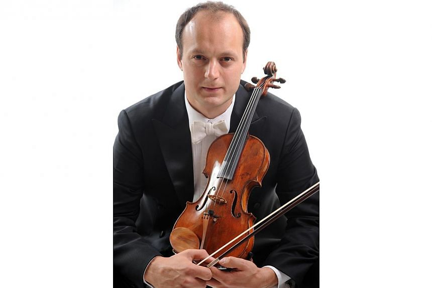 Yuzefovich has already made his mark with his polished and thoughtful solos as Singapore Symphony Orchestra's concertmaster, but brought things to a whole new level in the opening Nocturne of the concerto.-- PHOTO: SSO