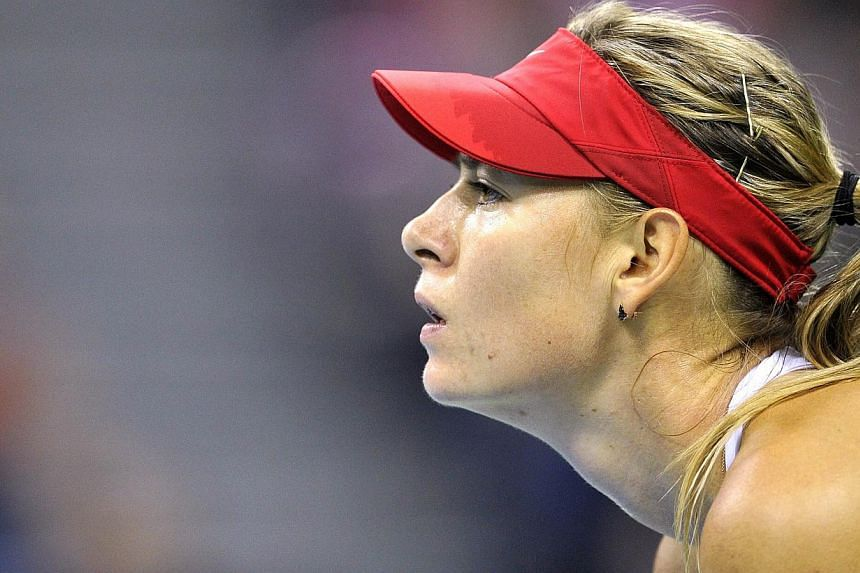 Maria Sharapova (above) defeated Urszula Radwanska 6-0, 6-3 as Russia took a 2-0 lead over Poland in the Fed Cup World Group Saturday with the superstar taking a first step towards the Rio Olympics. -- PHOTO: AFP