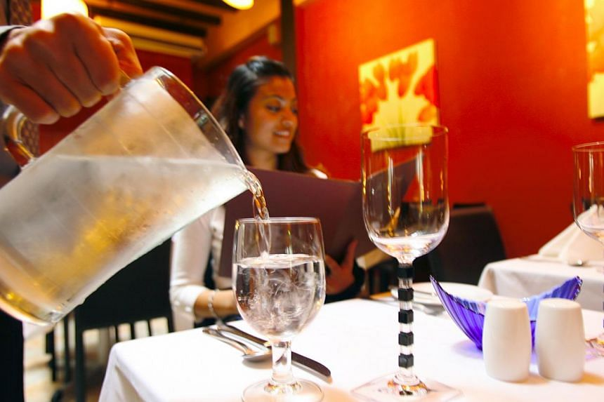Over 85 per cent of 1,700 people who took part in a Straits Times online poll said they would not pay for tap water while eating out at a restaurant. -- ST FILE PHOTO