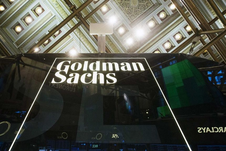 A Goldman Sachs sign is seen above the floor of the New York Stock Exchange after the opening bell, in this file photo taken Jan 24, 2014. -- PHOTO: REUTERS