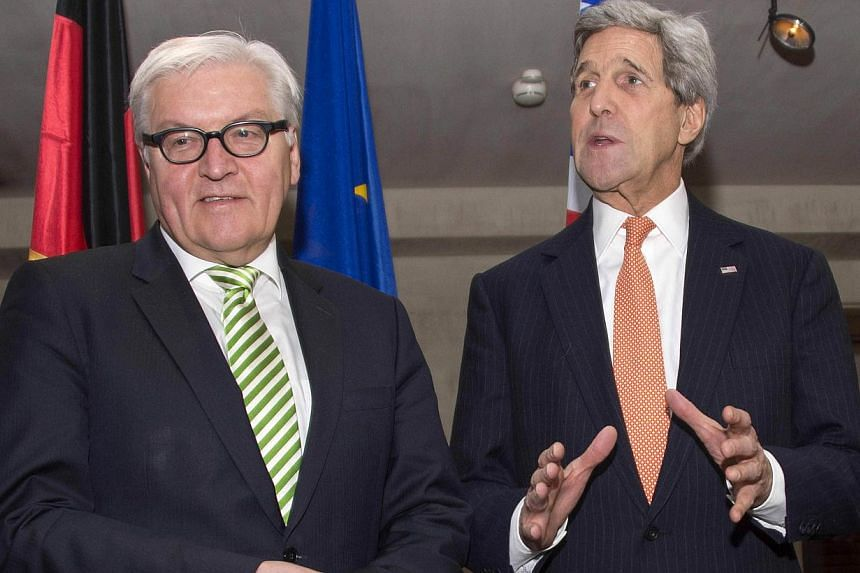German Foreign Minister Frank-Walter Steinmeier (left) with US Secretary of State John Kerry (right) at the Munich Security Conference in Germany, Feb 7, 2015. -- PHOTO: AFP