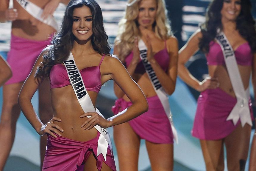 Colombia's Marxist Farc rebels have invited the newly-crowned Miss Universe Paulina Vega (above left), a native of the country's Caribbean coast, to attend their peace negotiations with the government, a bid to end 50 years of fighting. -- PHOTO: EPA